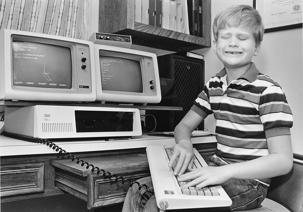 ©1990 Blind boy, Sam Hartman works on IBM computer, early 1990's.  Hartman later went to school at MIT and works in computer programing 2021.