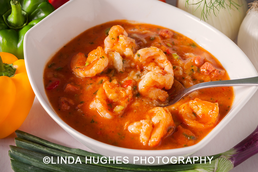 Close up of seafood gumbo with fresh ingredients