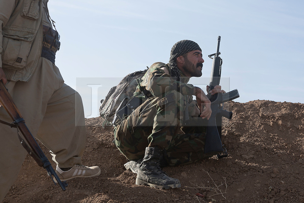 20/10/2016. Bashiqa, Iraq. A peshmerga fighter pauses behind an earthen berm during a large offensive to retake ISIS held areas around Bashiqa near Mosul today (20/10/2016).<br /> <br /> Launched in the early hours of today with support from coalition special forces and air strikes, the attack is part of the larger operation to retake Mosul from the Islamic State, and involves both the Kurds and the Iraqi Army. The city of Bashiqa, around 9 miles north of Mosul, is one of several gateway areas that must be taken before any attempted offensive on Mosul itself.<br /> <br /> Despite the peshmerga suffering several casualties after militants fought back using mortars, heavy machine guns and snipers, the Kurdish forces were quickly taking ground with Haider al-Abadi, the Iraqi prime minister, stating that the operation to retake Mosul was progressing faster than expected. Photo credit: Matt Cetti-Roberts/LNP