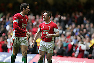 Wales try scorers James Hook (l) and Shane Williams celebrate after the match.  RBS Six nations championship 2010, Wales v Italy at the Millennium Stadium in Cardiff  on Sat 20th March 2010. pic by Andrew Orchard, Andrew Orchard sports photography,