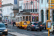 Yellow heritage tram No. 24 on the street of Lisbon. Lisbon tramway network operates since 1873. Photographed on Rua D. Pedro V