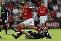Photo: Paul Thomas.<br /> Walsall v Swansea. Coca Cola League 1.<br /> 27/08/2005.<br /> <br /> Kris Taylor and Owain Tudor-Jones.