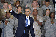 President Barack Obama waves to the crowd of military personnel after speaking at U.S. Central Command (CentCom) at MacDill Air Force Base in Tampa, Fla., Wednesday, Sept. 17, 2014. Obama received a briefing Wednesday from officers at U.S. Central Command. That command oversees military efforts in the Mideast.(AP Photo/Phelan M. Ebenhack)