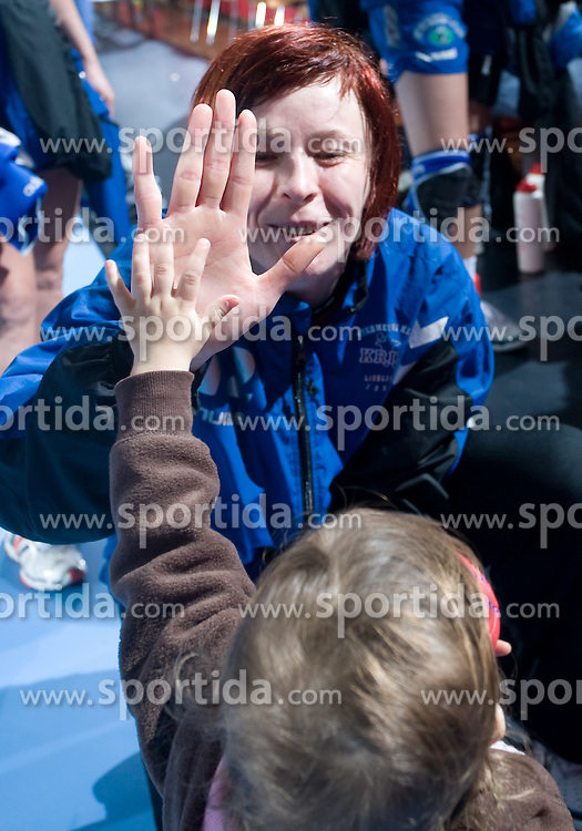 Goalkeeper of Krim Sergeja Stefanisin playing with a child after EHF Champions league handball match in Group II between RK Krim Mercator and Gyori Audi Eto KC, on February 7, 2009, in Kodeljevo, Ljubljana, Slovenia. Gyori won 35:31. (Photo by Vid Ponikvar / Sportida)