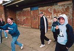 Children playing near shops; Bradford council estate UK