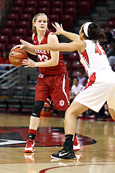 30 January 2015:  Anneke Schlueter holds her dribble back when confronted by Mackenzie Freeman during an NCAA women's basketball game between the Bradley Braves and the Illinois Sate Redbirds at Redbird Arena in Normal IL