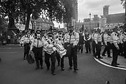 Police removing demonstrator blocking the road, Extinction Rebellion, Westminster,  London. 2 September 2020.