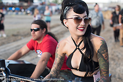 Iron Lily Kissa Von Addams with Brad Gregory in front of the stage at the Buffalo Chip during the annual Sturgis Black Hills Motorcycle Rally.  SD, USA.  August 10, 2016.  Photography ©2016 Michael Lichter.