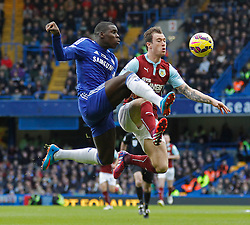 Chelsea's Kurt Zouma and Burnley's Michael Keane compete for the ball - Photo mandatory by-line: Mitchell Gunn/JMP - Mobile: 07966 386802 - 21/02/2015 - SPORT - Football - London - Stamford Bridge - Chelsea v Burnley - Barclays Premier League