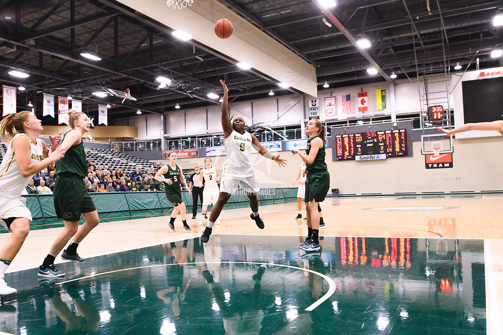 2nd year guard Kyanna Giles (9) of the Regina Cougars during the Women's Basketball pre-season game on October 14 at Centre for Kinesiology, Health and Sport. Credit: Arthur Ward/Arthur Images