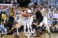 01 December 2015: North Carolina's Joel Berry II (center) tries to steal a pass from Maryland's Melo Trimble (left) to Diamond Stone (right). The University of North Carolina Tar Heels hosted the University of Maryland Terrapins at the Dean E. Smith Center in Chapel Hill, North Carolina in a 2015-16 NCAA Division I Men's Basketball game. UNC won the game 89-81.