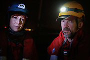 Victoria Henry and Phill Ball, pre-dawn, ahead of the their bording of the cargo ship September 21st 2017, Thames Estuary, Kent, United Kingdom. Greenpeace volunteers in kayaks, speed boats and climbers on the jetty prevent the 23,498-tonne cargo ship Elbe Highway from docking at Sheerness in Kent.  The cargo ship is bringing Volkswagen diesel cars into the UK and the Greenpeace action is to prevent this from happening and to make VW ditch diesel. Two climbers board the ship and hang a banner on the roll-on roll-off part of the ship preventing any cars from being off-loaded.The action is part of a long running Greenpeace campaign to curb diesel emmissions and air pollution broght on by diesel cars.