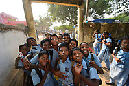 Children in school uniform outside CRINEO school, Pulicat Lake, Tamil Nadu, India