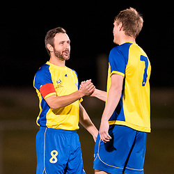 BRISBANE, AUSTRALIA - AUGUST 26: Brisbane Strikers captain Michael Angus shakes hands with Michael Lee of the Strikers before the NPL Queensland Senior Men's Semi Final match between Brisbane Strikers and Moreton Bay Jets at Perry Park on August 26, 2017 in Brisbane, Australia. (Photo by Patrick Kearney)