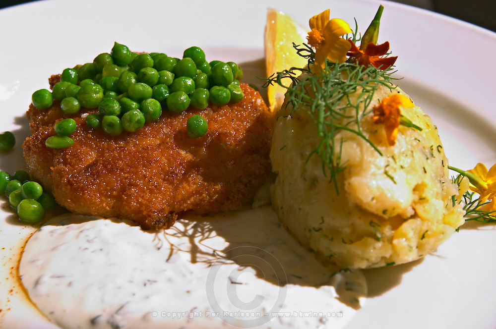 Pan fried fish burger with mashed potatoes and herb sauce. Restaurant PM and Friends (PM och Vanner) Vaxjo town. Smaland region. Sweden, Europe.