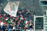 Un fumogeno brucia accanto al settore dei tifosi della Juventus <br /> Fireworks thrown on Juventus supporters.  Before the match, Torino fans attacked the Juventus bus breaking a window<br /> Torino 26-04-2015, Stadio Olimpico, Football Calcio 2014/2015 Serie A TIM, Torino - Juventus, Foto Insidefoto