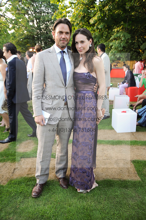 DOUGRAY SCOTT and CLAIRE FORLANI at the annual Serpentine Gallery Summer party this year sponsored by Jaguar held at the Serpentine Gallery, Kensington Gardens, London on 8th July 2010.  2010 marks the 40th anniversary of the Serpentine Gallery and the 10th Pavilion.
