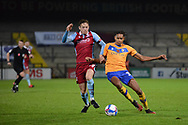 Alfie Beestin (22) of Scunthorpe United Alistair Smith (30) of Mansfield Town battles for possession during the EFL Trophy match between Scunthorpe United and Mansfield Town at the Sands Venue Stadium, Scunthorpe, England on 10 November 2020.
