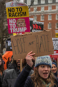 Outside the US Embassy - A march against racism and to ban the ban (against immigration from certain countries to the USA) is organised by Stand Up To Racism and supported by Stop the War and several unions. It stated with a rally at the US Embassy in grosvenor Square and ended up in Whitehall outside Downing Street. Thousands of people of all races and ages attended. London 04 Feb 2017.