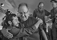 Harris Paseltiner, left gets a hug from Steve Seskin after the Community Celebration concert Sunday morning session of the Sisters Folk Festival.