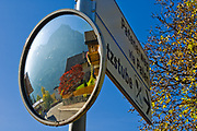 Tyrolian village traffic mirror, the Schlern backdrop (2, 563 meters elevation), October, Dolomite Mountains, N.E. Italy