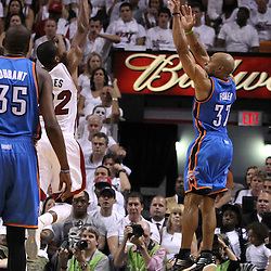 Jun 17, 2012; Miam, FL, USA; Oklahoma City Thunder point guard Derek Fisher (37) shoots a three point shot against the Miami Heat during the fourth quarter in game three in the 2012 NBA Finals at the American Airlines Arena. Mandatory Credit: Derick E. Hingle-US PRESSWIRE