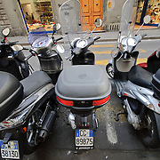 Italian scooters parked on the street in Firenze