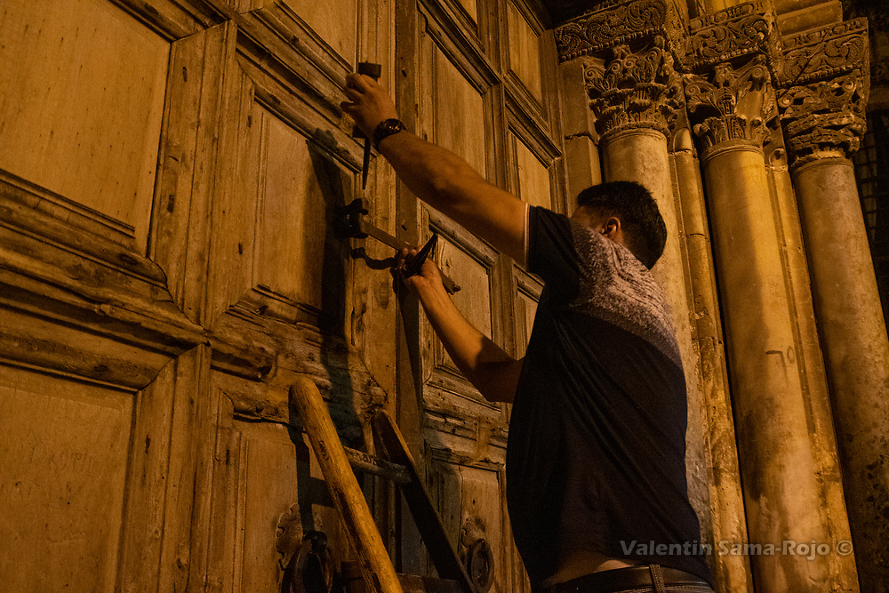 Jerusalem, Israel. 23rd August, 2019. A member of Joudeh Al-Goudia family closing the doors of the Church of the Holy Sepulchre. © Valentin Sama-Rojo