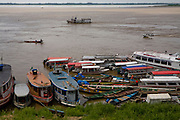 Boats docking on the Solimoes River in Mancapuru, Brazil. Riverboats ply the network of rivers that drain the vast Amazon basin which has very few roads.