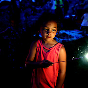 Isabel Cutwright, 7, of Toledo, uses a sparkler ahead of fireworks during an early Independence Day celebration at Fort Meigs in Perrysburg, Ohio, on Wednesday, July 3, 2019. THE BLADE/KURT STEISS