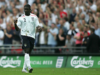 Photo: Lee Earle.<br /> England v Israel. UEFA European Championships Qualifying. 08/09/2007.Micah Richards celebrates after scoring England's third goal.