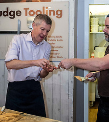 Pictured: Willie Rennie tries the fruit of his labours from Will Tebbutt<br /><br />Scottish Liberal Democrat leader Willie Rennie visited the Fudge Kitchen on Edinburgh's Royal Mile to talk about the need to protect Scottish businesses from independence.  I don't think master fudge maket Will Tebbutt needs t6o worry about his job.<br /><br />Ger Harley | EEm 2 December 2019