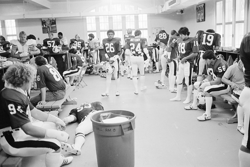 COLLEGE FOOTBALL:  Stanford vs San Jose State on October 4, 1980 at Stanford Stadium in Palo Alto, California.  Stanford team pre-game locker room.  Mike Teeuws #57, Mike Tolliver #26, Mike Dotterer #24, Phil Wilson #18, Mark Mordell #26, Louis Arvanetes #56.  Photograph by David Madison ( www.davidmadison.com ).