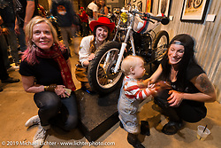 The ladies hanging with little Lock Olsen; Left to Right Susan McLaughlin, Brittney Olsen, and Karlee Cobb Saturday at the Handbuilt Motorcycle Show. Austin, TX. April 11, 2015.  Photography ©2015 Michael Lichter.