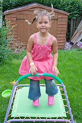 Little girl bouncing on a trampoline,