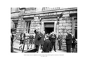 Seán Lemass waves to supporters outside Leinster House following his re-election as Taoiseach.<br />