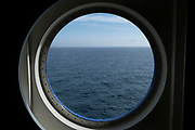 Sea view through a porthole aboard a Brittany Ferries roll-on / roll-off car and vehicle ferry on 26th September 2021 in Roscoff, Brittany, France. Brittany Ferries is the trading name of the French shipping company, BAI Bretagne Angleterre Irlande S.A. founded in 1973 by Alexis Gourvennec, that operates a fleet of ferries and cruise ferries between France and the United Kingdom.