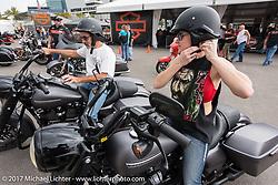 Test riding the new 2017 Harleys at the Harley-Davidson display at the Daytona International Speedway during Daytona Beach Bike Week. FL. USA. Sunday March 12, 2017. Photography ©2017 Michael Lichter.