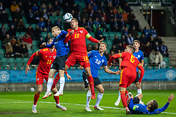 TALLINN, ESTONIA - Monday, October 11, 2021: Wales' captain Aaron Ramsey (R) challenges for a header with Estonia's Taijo Teniste during the FIFA World Cup Qatar 2022 Qualifying Group E match between Estonia and Wales at the A. Le Coq Arena. Wales won 1-0. (Pic by David Rawcliffe/Propaganda)