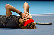 Alexander 'Sasha' Zverev of Germany on the ground after winning his finals match during the Nitto ATP Tour Finals at the O2 Arena, London, United Kingdom on 18 November 2018. Photo by Martin Cole