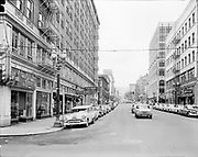 Simon 048. Looking south down SW 10th from Stark. Governor Hotel on right. March 27, 1956