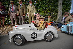 © Licensed to London News Pictures.09/09/2018. Goodwood. West Sussex, UK. <br /> The Goodwood motor circuit celebrates the 20th anniversary of the Revival.The Revival has become one of the biggest annual historic motorsport events in the world and the only one to be staged entirely in period dress. Each year over 150,000 people descend on this quiet corner of West Sussex to enjoy the three-day event.<br /> Pictured. The young drivers entering the Setterington Cup in their Austin J40 pedal cars. <br /> Photo credit: Ian Whittaker/LNP