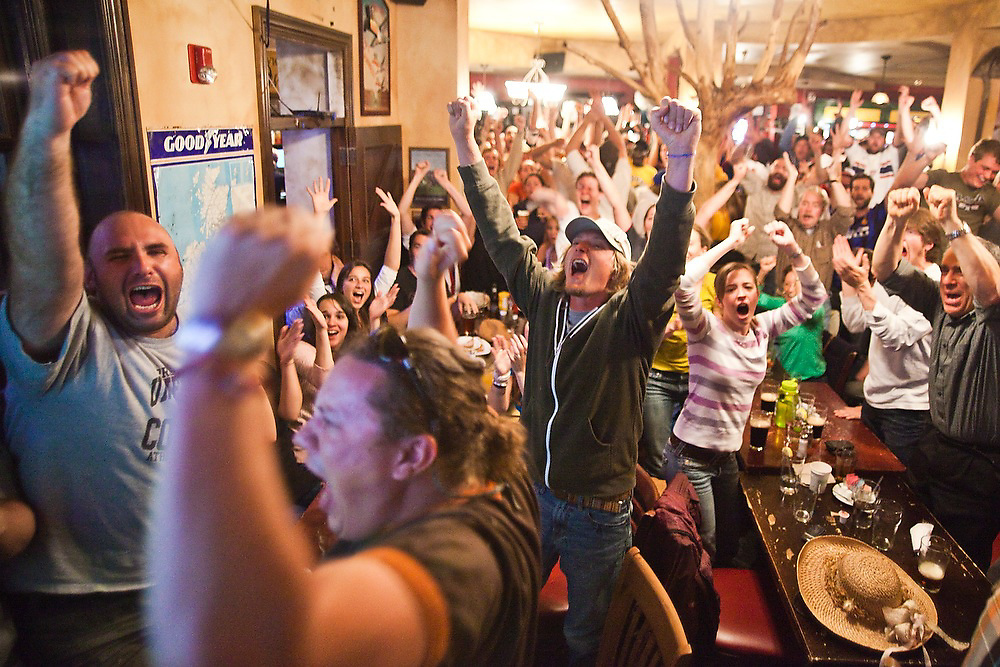 Crowds of spectators at Conor O'Neill's pub in Boulder, Colorado jump for joy as Clint Dempsey scores a goal for the US during the World Cup soccer match between England and the USA on June 12, 2010. The match ended in a 1-1 tie.