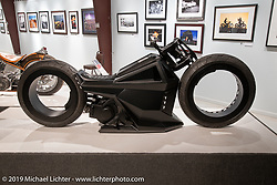 Tim McNamer's Ballistic Cycles single side swingarm, double hub-less, electric custom in the More Mettle - Motorcycles and Art That Never Quit exhibition in the Buffalo Chip Events Center Gallery during the Sturgis Motorcycle Rally. SD, USA. Tuesday, August 10, 2021. Photography ©2021 Michael Lichter.