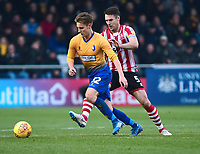 Mansfield Town's Danny Rose shields the ball from  Lincoln City's Jason Shackell<br /> <br /> Photographer Andrew Vaughan/CameraSport<br /> <br /> The EFL Sky Bet League Two - Lincoln City v Mansfield Town - Saturday 24th November 2018 - Sincil Bank - Lincoln<br /> <br /> World Copyright © 2018 CameraSport. All rights reserved. 43 Linden Ave. Countesthorpe. Leicester. England. LE8 5PG - Tel: +44 (0) 116 277 4147 - admin@camerasport.com - www.camerasport.com