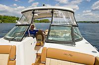 Heading down Paugus Bay towards Irwin Marine with Jason Wylie in a 2015 Sea Ray 350 SLX.  (Karen Bobotas/for the Laconia Daily Sun)