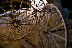 close up of wooden old west wagon wheels