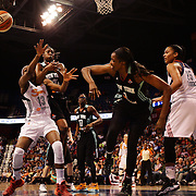 Chiney Ogwumike, (left), Connecticut Sun, is hit hard by Tina Charles, New York Liberty, as they challenge for a rebound watched by DeLisha Milton-Jones, (centre, right), New York Liberty and Alyssa Thomas, (right), Connecticut Sun, during the Connecticut Sun Vs New York Liberty WNBA regular season game at Mohegan Sun Arena, Uncasville, Connecticut, USA. 16th May 2014. Photo Tim Clayton