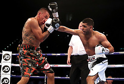Amir Khan (right) and Samuel Vargas in action during their Welterweight contest at Arena Birmingham, Birmingham