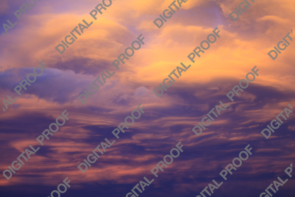 A dramatic and colorful cloudy sunset sky with violet and hints of yellow